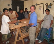 A picture of boys at workbenches making cedar boxes.